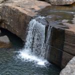 Sabia que há mais de 300 rios enterrados embaixo do asfalto em SP? Descubra onde estão!