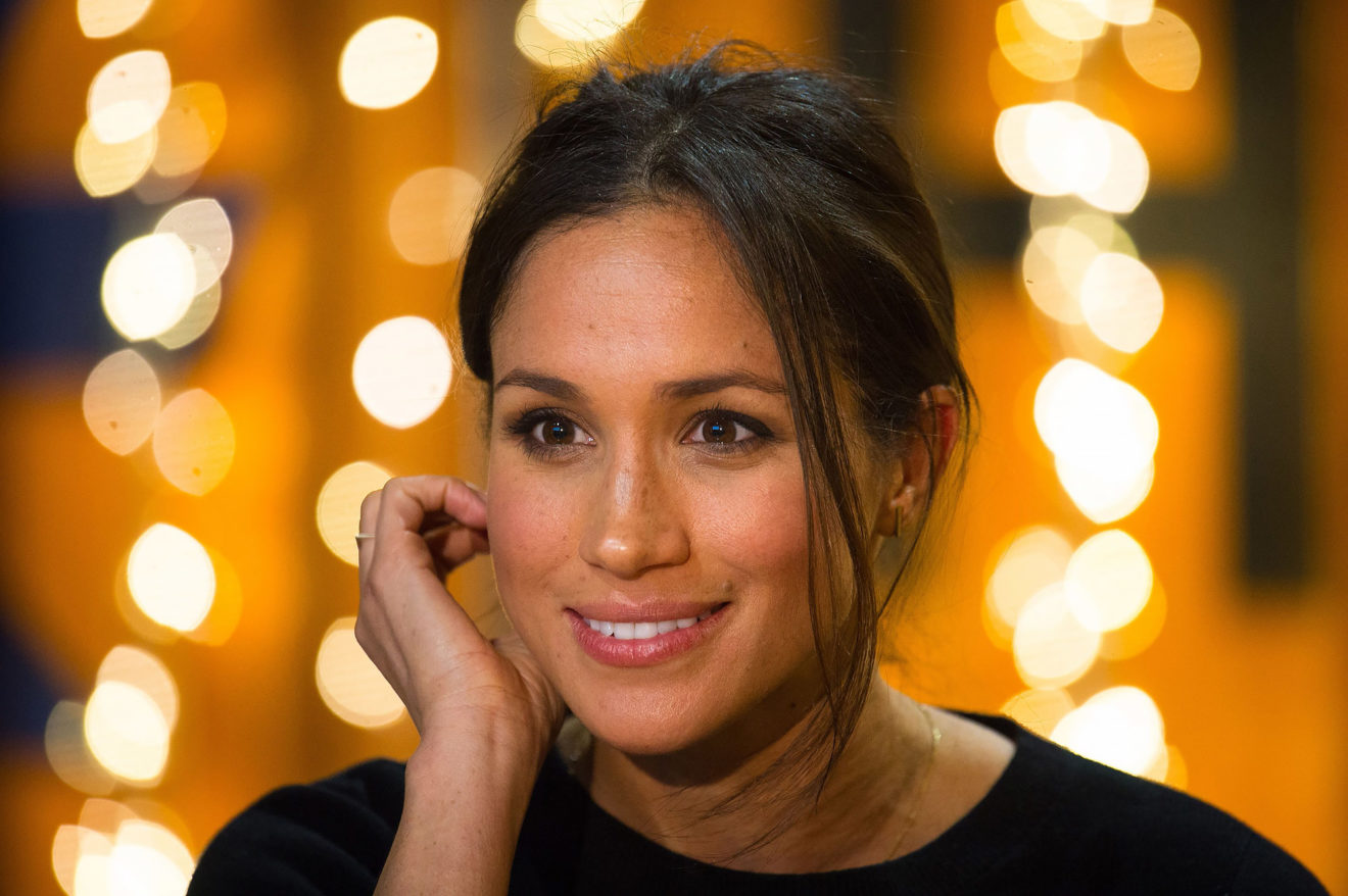 Britain's Prince Harry's fiancée US actress Meghan Markle gestures  during a visit to Reprezent 107.3FM community radio station in Brixton, south west London on January 9, 2018.   / AFP PHOTO / POOL / Dominic LipinskiDOMINIC LIPINSKI/AFP/Getty Images